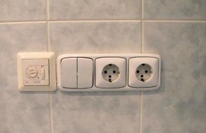 Розетка с выключателем для ванной